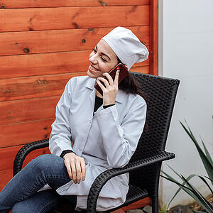 doctor-smiling-on-phone
