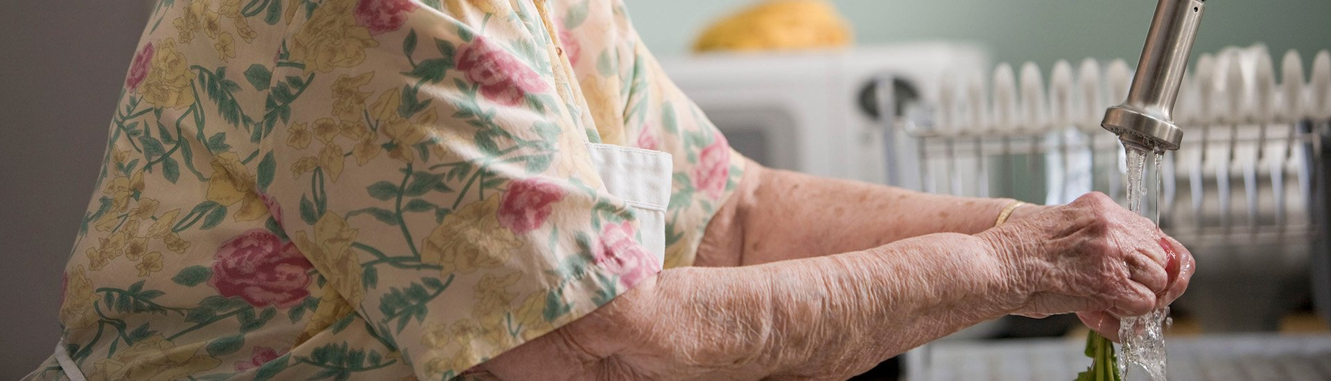 older-person-washing-hands
