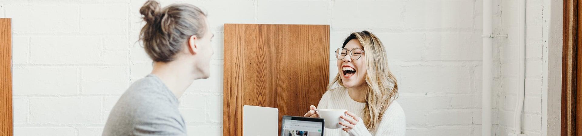 two-people-talking-laughing