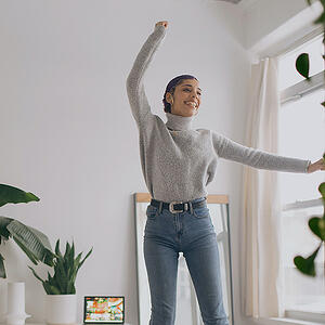 woman-happy-at-home-moving-jumping